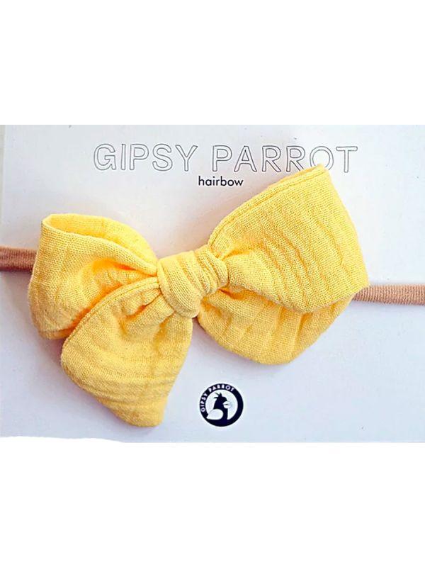 Kaunis ja suloinen Gipsyparrot merkin banana Muslin collection rusettipanta vauvalle. Kaikki rusettpannat ommellaan käsin. Kankaat ovat pehmeitä eikä nauha kiristä eikä purista vauvan päätä.