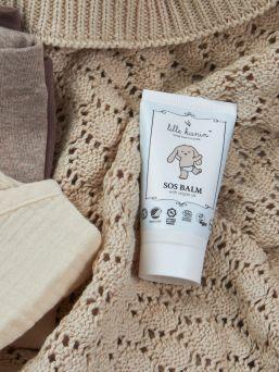 Lille Kanin SOS Balm on kosteuttava ja rauhoittava balmi, joka suojaa ihoa ja palauttaa ärtynyttä ihoa voimaan paremmin. Balmi sopii erittäin hyvin myös imettävän äidin nänneille.