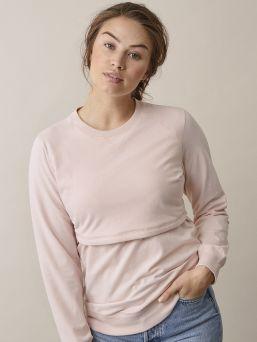Boob Design B-Warmer Sweatshirt imetyspaita pitää rinnat lämpimänä niin paukkuvilla pakkasilla kuin koleilla kesäiltoina. Paita on kaksinkertaista kangasta rintojen kohdalta ja alempi kerros lämmintä fleeceä.